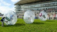 Sport stars take part in Zorbing Derby for charity at Galway races