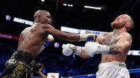 Floyd Mayweather retires with perfect record by stopping Conor McGregor in mismatch
