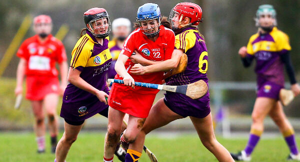 Cork's Aileen Sheehan is tackled by Wexford's Sarah O'Connor. Pic: ©INPHO/Ken Sutton
