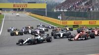 Lewis Hamilton holds off Vettel to close championship title gap