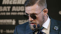 Conor McGregor makes gambling jibe to Floyd Mayweather in subdued press conference