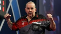 Phil Taylor eases into World Championship quarter-finals