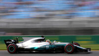 Hamilton secures Malaysian pole as engine trouble leaves Vettel at back of grid
