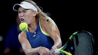 Caroline Wozniacki progresses after late finish at Australian Open