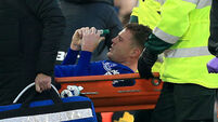 James McCarthy pictured smiling in hospital bed after successful surgery on horror injury
