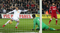 Bottom-side Swansea stun high-flying Liverpool