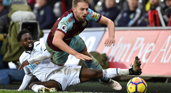 Burnley's Charlie Taylor reacts to a challenge from Swansea City's Nathan Dyer at the Liberty Stadium. Photo: Simon Galloway/PA