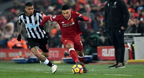 Newcastle United's Robert Kenedy (left) and Liverpool's Alex Oxlade-Chamberlain battle for the ball during the Premier League match at Anfield, Liverpool. Pic: Anthony Devlin/PA Wire.