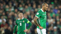 Josh Magennis dejected after conceding their first goal 9/11/2017
