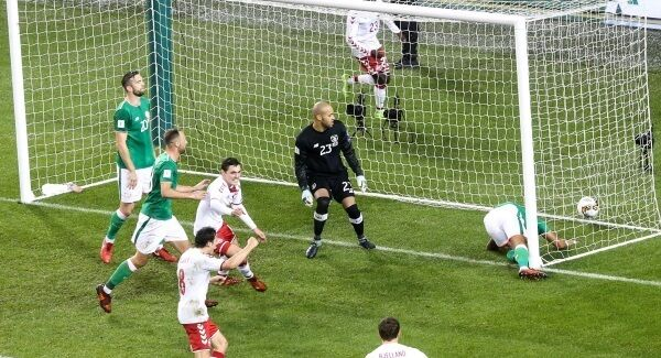 Denmark's Andreas Christensen takes a shot that went in off Cyrus Christie for their first goal. Photo: INPHO/Gary Carr
