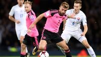 Skrtel own goal keeps Scotland's World Cup hopes alive