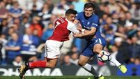 Arsenal battle to deserved point at 10 man Chelsea