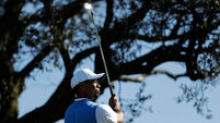 Tiger Woods takes lead in second round of comeback event