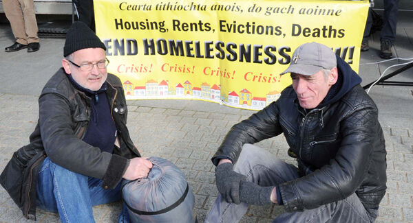 Councillor Diarmaid Ó Cadhla (left) and Tony Walsh, chairman, Housing Action Group, at a 24-hour protest outside City Hall in February