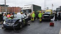 Three taken to hospital after four car collision involving Garda car on Dublin's South Quays