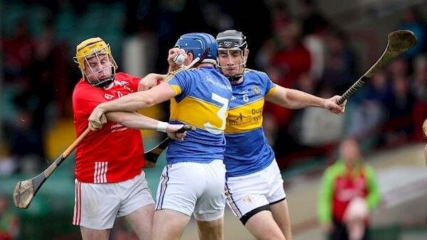 Doon's Dean Coleman is tackled by Nigel Foley of Patrickswell. Picture: INPHO/Oisin Keniry