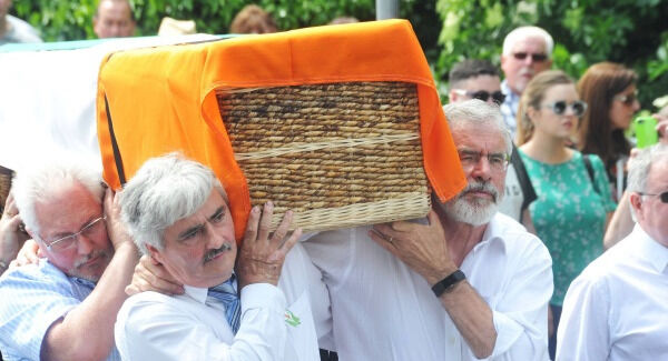 Gerry Adams TD and Cllr Michael Gallagher carry Joe Reilly's coffin.