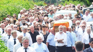 Gerry Adams leads mourners at funeral of Sinn Féin's Joe Reilly