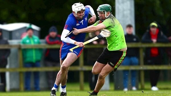 Mary Immaculate College Limerick's Tim O'Mahony with IT Carlow's Sean Downey. (©INPHO/Tom O'Hanlon)