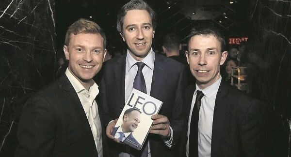 Philip Ryan, left, and Niall O'Connor, joint authors of 'Leo: A Very Modern Taoiseach', with Health Minister Simon Harris at the launch of the biography in Dublin.