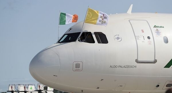 Flags are flown from the plane carrying Pope Francis as it arrives at Dublin International Airport, at the start of his visit to Ireland. Picture: Brian Lawless/PA Wire