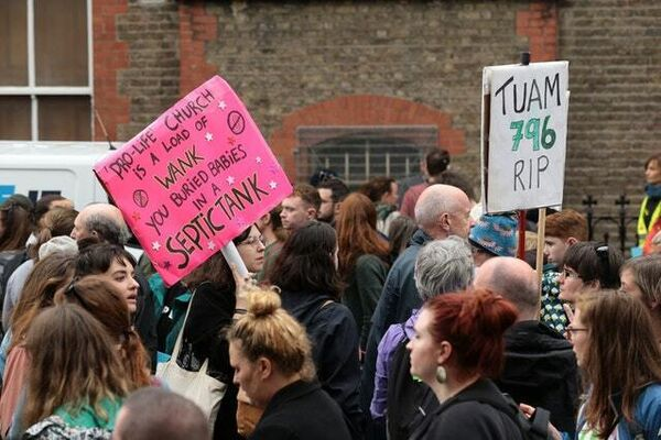 The Stand4Truth rally gathers outside a former Magdalene laundry (Aaron Chown/PA)