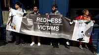 Protesters gather at Dublin Castle to condemn treatment of abuse victims