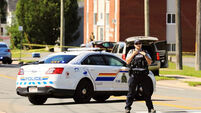 Latest: Two police among four people dead after Canada shooting; suspect treated for 'serious injuries'