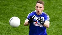 Clare in relegation trouble after evergreen Munnelly leads Laois to narrow win