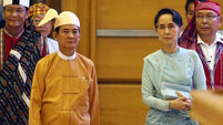 Aung San Suu Kyi loyalist sworn in as new president of Burma
