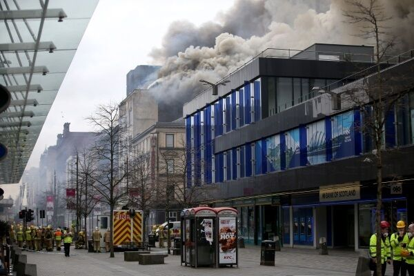 The scene in Glasgow city centre where firefighters are tackling a large blaze on Sauchiehall Street near the junction with Hope Street.