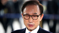 South Korean prosecutors seek arrest warrant for ex-president