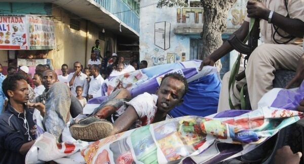 Injured civilians, wounded during a car bombing in Mogadishu, Somalia on Thursday March 22 are assisted. Photo credit: AP/Farah Abdi Warsameh