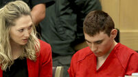 Florida school shooting suspected charged with 17 counts of murder