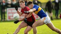 14-man Tipperary dig out deserved draw
