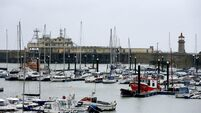 Man dies after being washed into harbour as wild weather batters parts of UK
