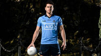 GAA star Bernard Brogan shares cute snap of him holding tiny newborn twins