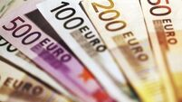 EU urges writeoffs of soured bank loans