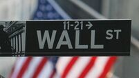 Stocks slip on Wall Street despite boost for technology companies