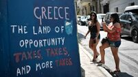 Don't cheer Greece's bailout exit just yet