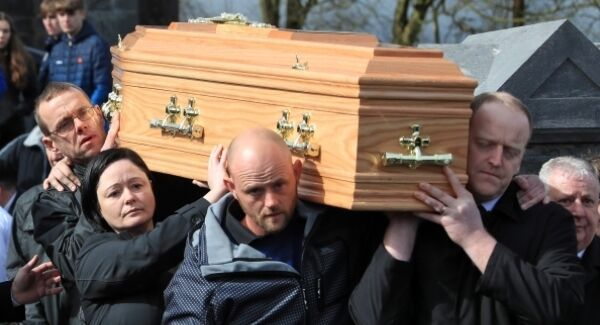 The remains of 14-year-old Elisha Gault are carried by her parents, Gráinne and Cameron (centre, and back left of coffin). Elisha's body was found in the River Suir eight days after she went missing on St Patrick's Day. Picture: Colin Keegan, Collins Dublin