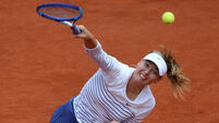 Maria Sharapova overcomes wobble to reach French Open second round