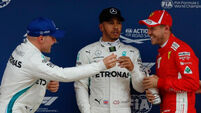Record-breaking lap gives Lewis Hamilton pole position in Spain