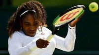 Serena plays down title talk as rivals feel the heat