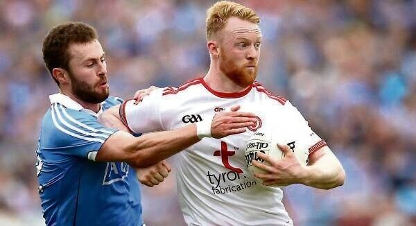 Tyrone's Hugh Pat McGeary holds off Dublin's Jack McCaffrey in last month's All-Ireland SFC quarter-final at Healy Park. Pic: Ryan Byrne