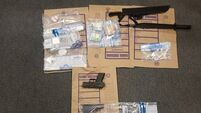 Drugs, cash, phones and machetes seized in searches in North Dublin