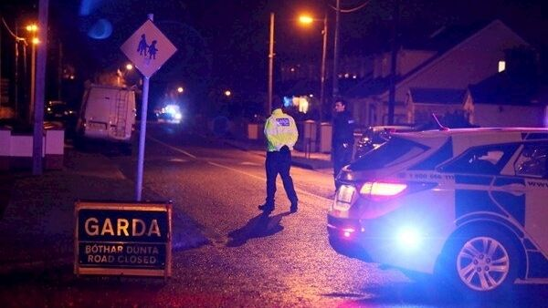 Gardaí at the scene in Blanchardstown last night. Pictures: PA