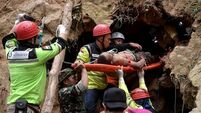 'Race against time' to rescue survivors after Indonesia mine collapse