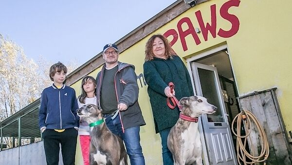 Film director and screenwriter Lenny Abrahamson with his children Max and Nell pictured with Gina Hetherington of Paws, as well as Ivy and Dobbie during the visit to the shelter. PIcture: Pat Moore