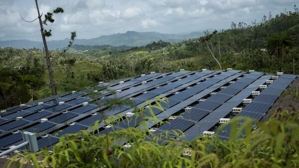 After Hurricane Maria, the company Tesla installed solar panels across Puerto Rico to restore electricity to communities without power. AP Photo/ Dennis M. Rivera Pichardo